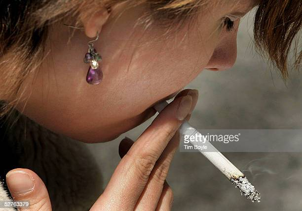 A woman smokes near a 'Rally Against Tobacco' highlighting the deaths caused by the use of tobacco and exposure to secondhand smoke on May 5 2005 in...