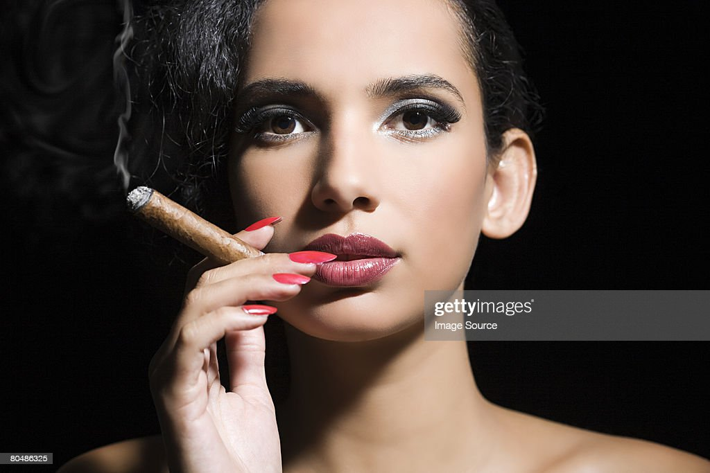 Woman smoking a cigar : Stock Photo