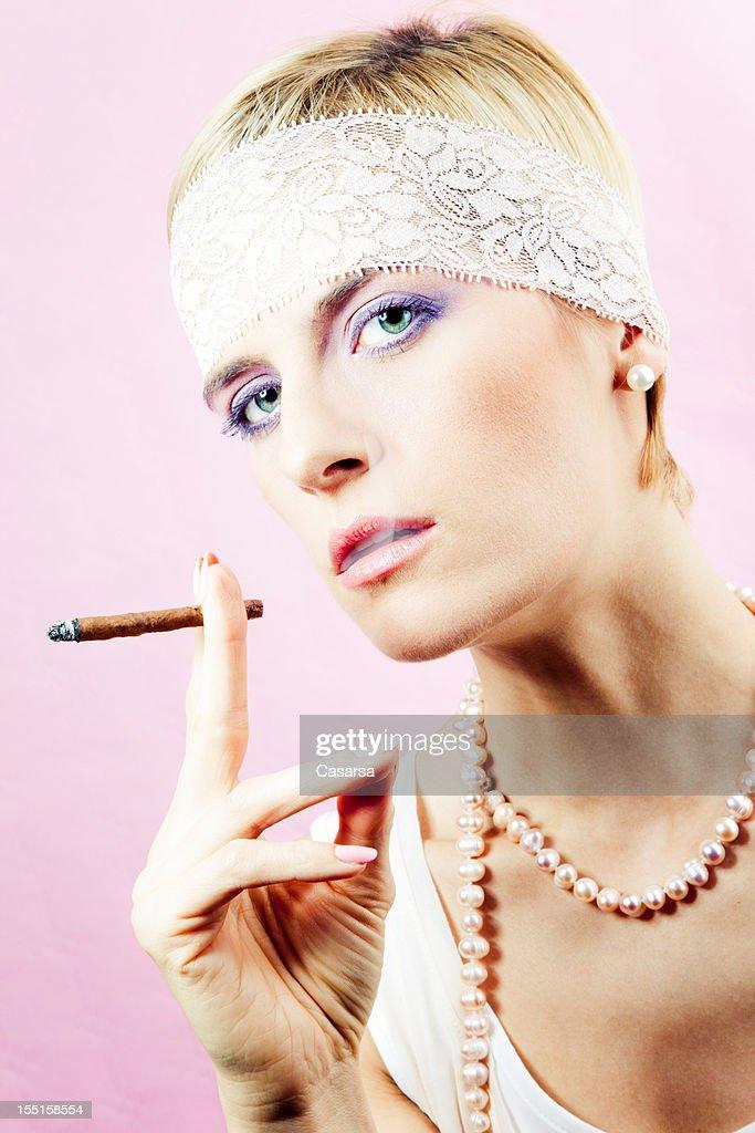Woman smoking a cigarillo
