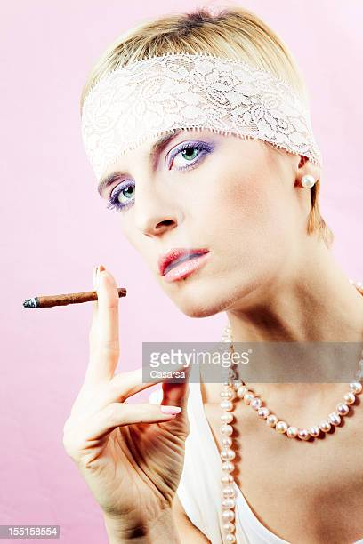 Woman smoking a cigarillo