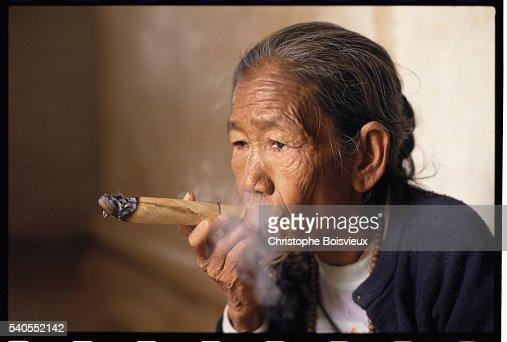 Woman Smoking Cheroot