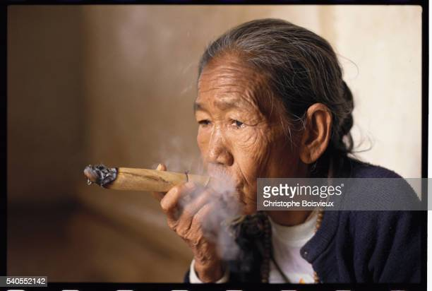Woman Smoking Cheroot