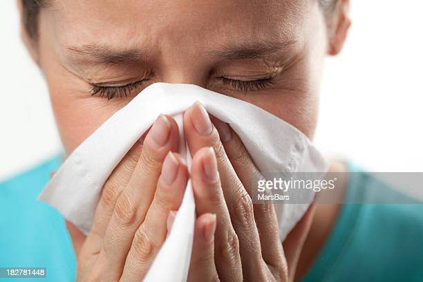 Woman sneezing close up