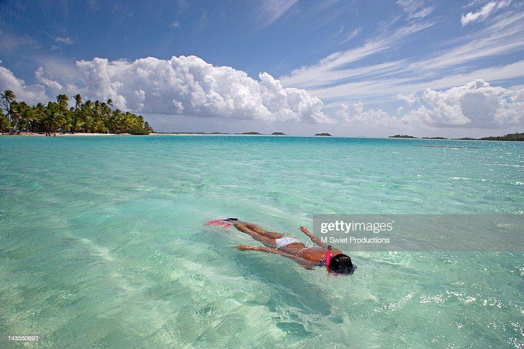 Woman snorkeling in blue lagoon