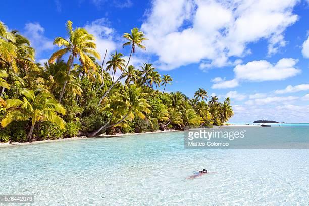 Woman snorkeling in the blue lagoon of Aitutaki
