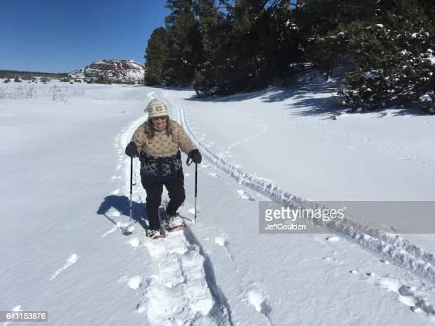 Woman Snowshoeing