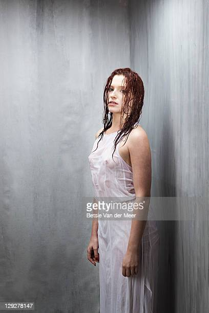 Woman soaked in water.