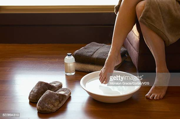 Woman soaking her feet
