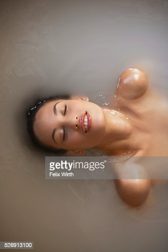Woman soaking in bath : Stock Photo