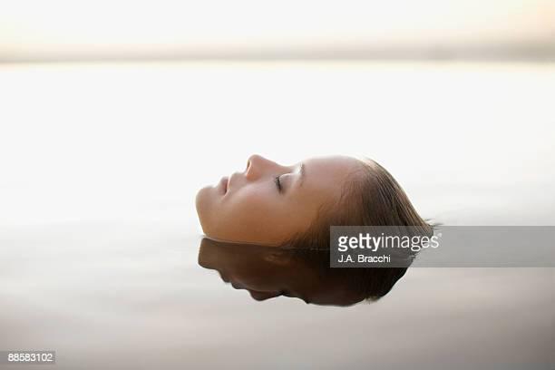 Woman soaking in swimming pool