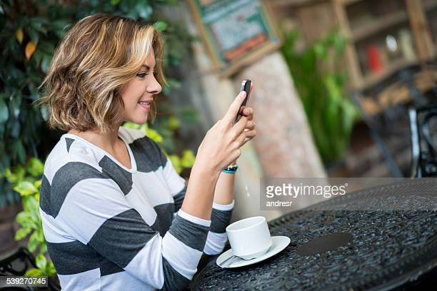 Woman social networking at a coffee shop