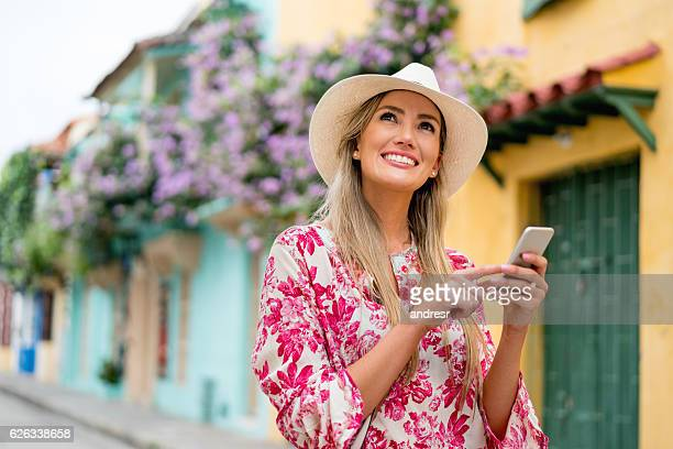 Woman social networking while traveling