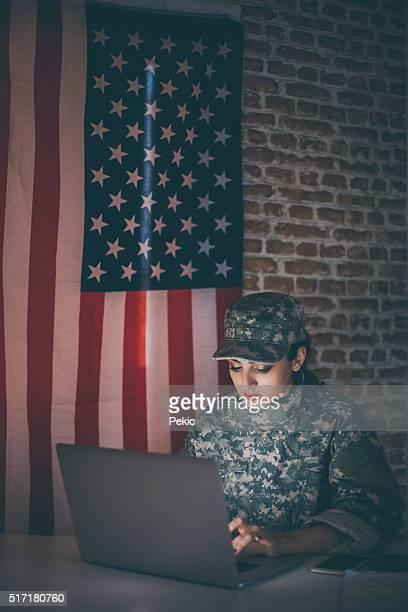 Woman soldier hacker trying to break firewall on website