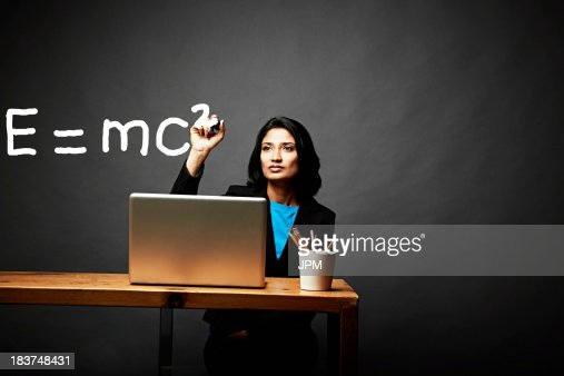 Woman solving a mathematical equation : Stock Photo
