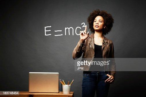Woman solving mathematical equation