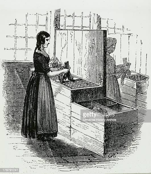 Woman sorting and cutting rags to be turned into paper Engraving c1845