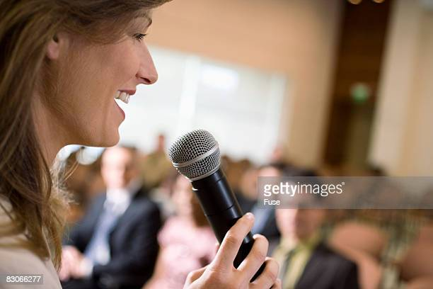 Woman Speaking at Conference