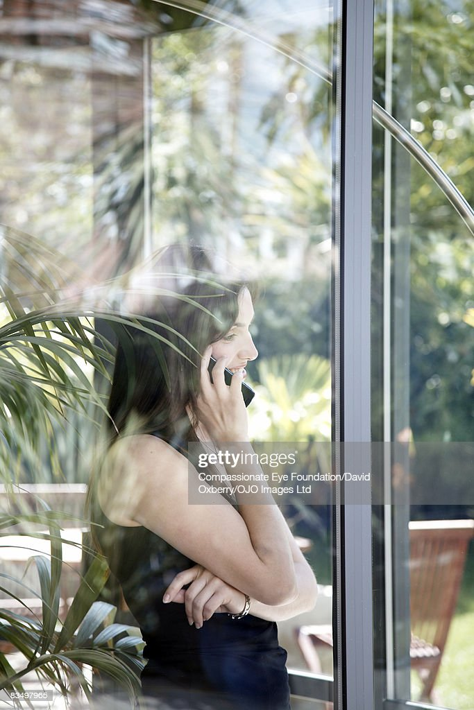 Woman speaking on mobile phone : Stock Photo