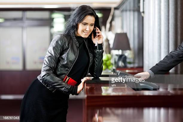 Woman speaking on the phone in a hotel