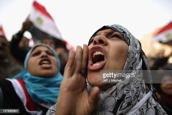 A woman speaks as Egyptians gather in Tahrir Square to mark the one year anniversary of the revolution on January 25 2012 in Cairo Egypt Tens of...
