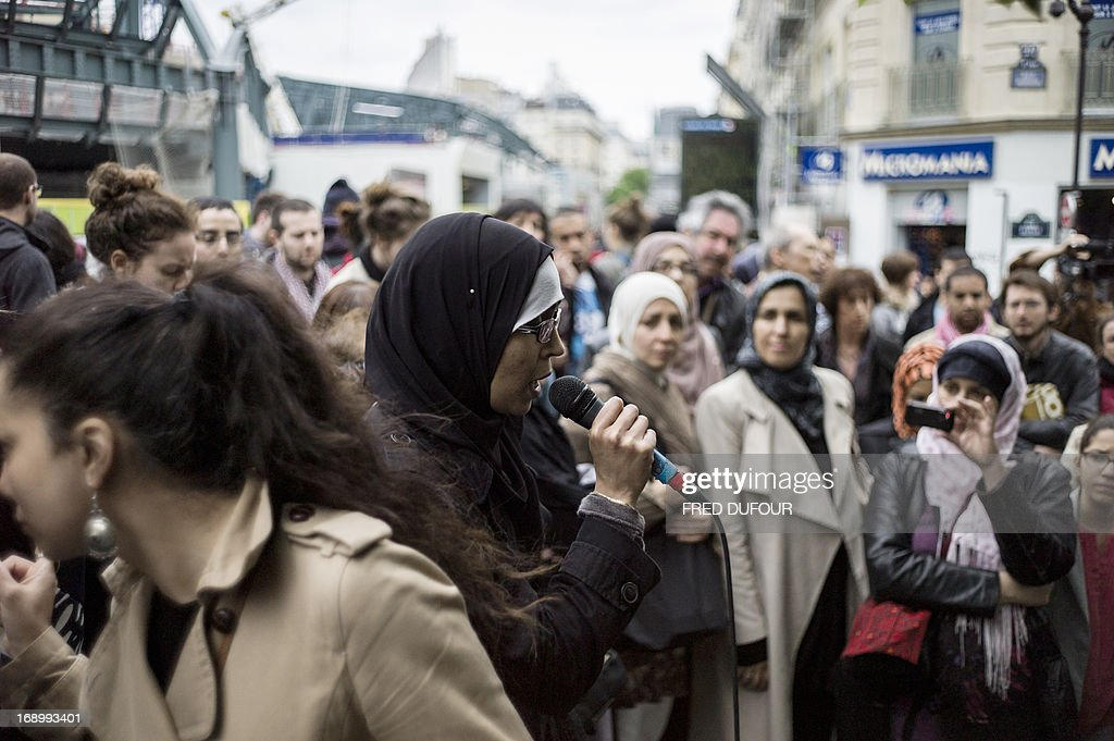 A woman speaks during a demonstration gathering veiled women, on May 18, 2013 in Paris, to ask for the right of veiled parents to take their children to school. Any overt religious symbols are banned from French state schools, which operate on strictly secular lines. France has banned the wearing of niqabs - veils which cover the full face - in public.