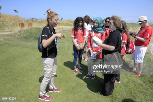 A woman speaks in sign language during a meeting for Turkish and foreign media members ahead of the golf games within the 23rd Summer Deaflympics...