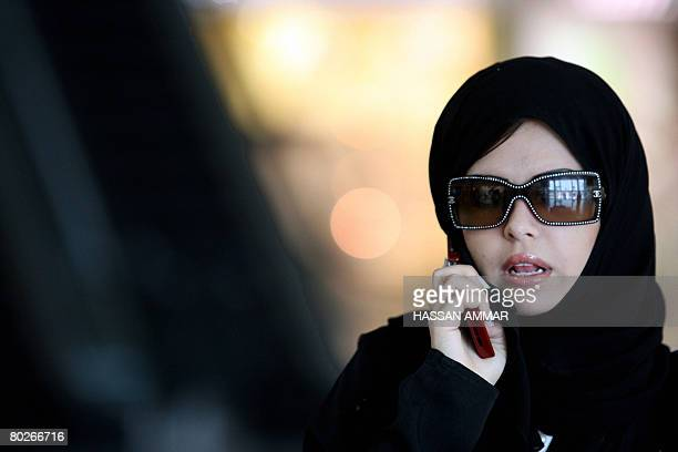 A woman speaks on her phone at a shopping mall in the Saudi capital of Riyadh on March 16 2008 AFP PHOTO/HASSAN AMMAR