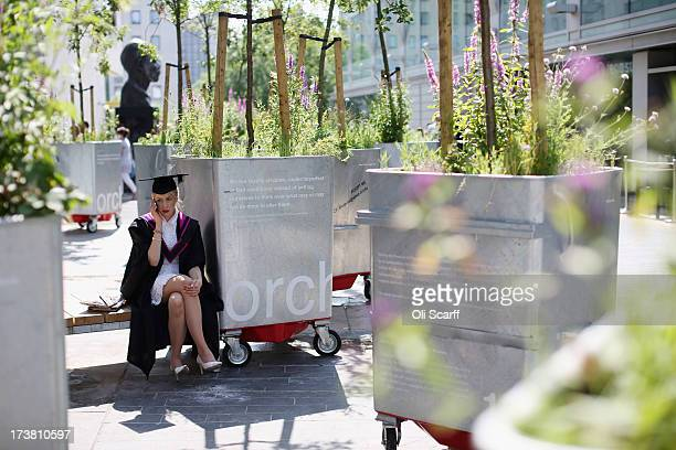 A woman speaks on the phone before attending a graduation ceremony in the Royal festival Hall on the Southbank on July 18 2013 in London England The...