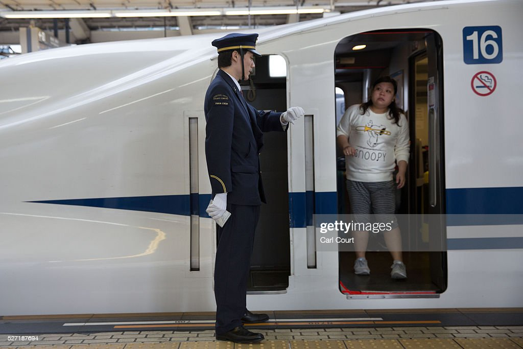 A woman speaks to a guard after boarding a Shinkansen bullet train at Tokyo Train Station on May 02, 2016 in Tokyo, Japan. The Shinkansen is a network of high-speed railway lines in Japan currently consisting of 2,764.6 km (1,717.8 mi) of lines with maximum speeds of 240-320 km/h (150-200 mph). The network presently links most major cities on the islands of Honshu and Kyushu, and Hakodate on northern island of Hokkaido. The maximum operating speed is 320 km/h (200 mph) though test runs have reached up to a world record 603 km/h (375 mph) for maglev trains in April 2015.