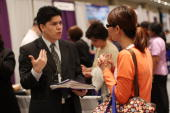 A woman speaks with job recruiter at a job fair for businesses in the medical profession on May 8 2009 in New York New York In new numbers released...