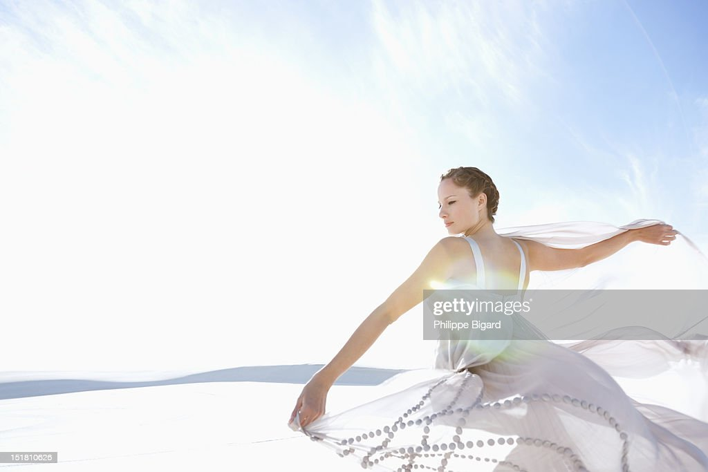 Woman spinning in dress : Stock Photo