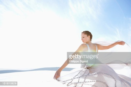 Woman spinning in dress : ストックフォト