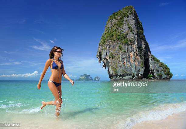 Woman splashing through the water at Railay Beach, Thailand (XXXL)