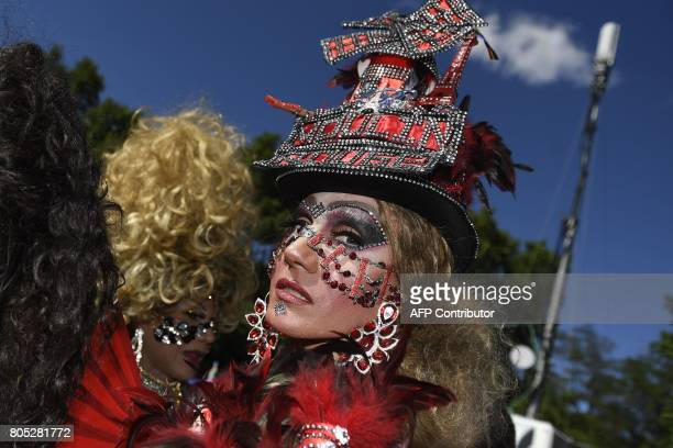 TOPSHOT A woman sporting a fancy hat representing the 'Moulin Rouge' looks on during the WorldPride 2017 parade in Madrid on July 1 2017 Revellers...