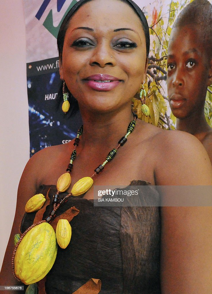 A woman sports a collar made of cocoa pods, on November 20, 2012, in Abidjan, prior to the opening of the first World Cocoa Conference. The London-based International Cocoa Organisation (ICCO) organised the event to discuss a sustainable future for the industry in the face of growing demand. The conference is of particular interest to Ivory Coast, which is the world biggest producer of cocoa. ICCO said Africa in particular was a key area for the cocoa industry, with countries there expected to produce 70 percent of the world cocoa output for 2011-2012 that the ICCO estimates at nearly four million tonnes. AFP PHOTO/ SIA KAMBOU