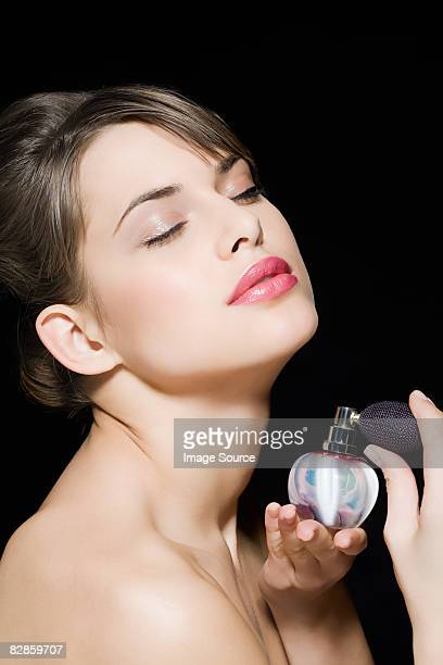 Woman spraying perfume