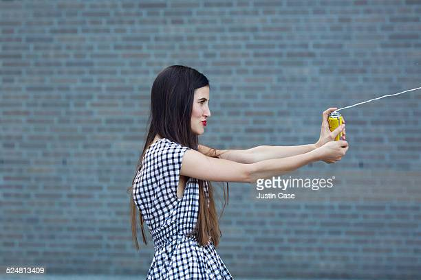 woman spraying spray string outdoors