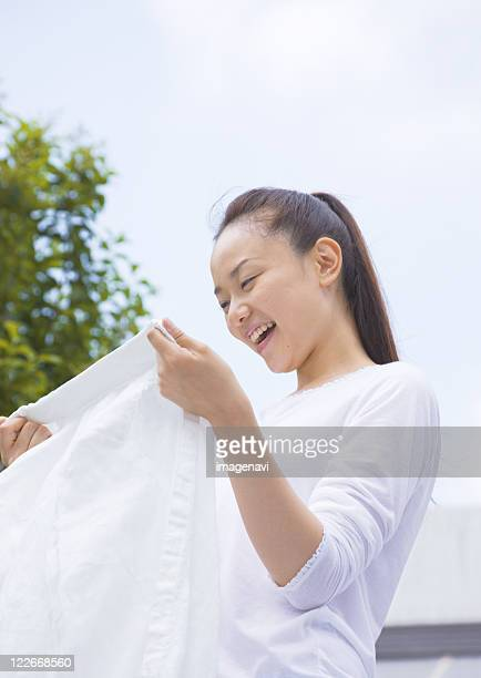 A woman spreading out laundry