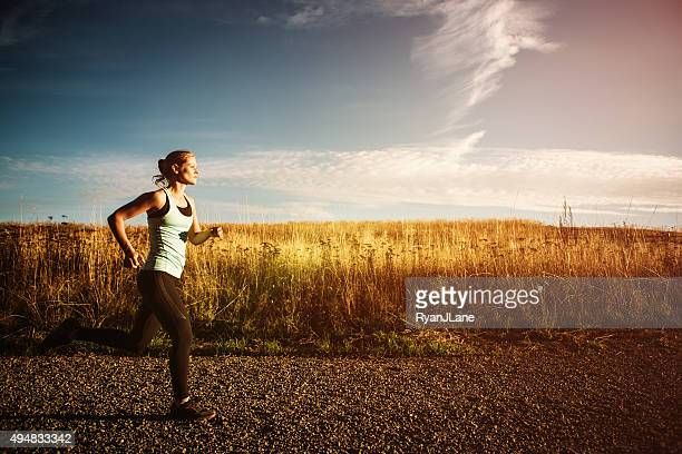 Woman Sprinting on Beautiful Sunset Road