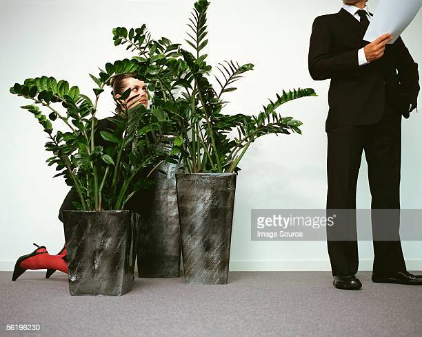 Woman spying on businessman