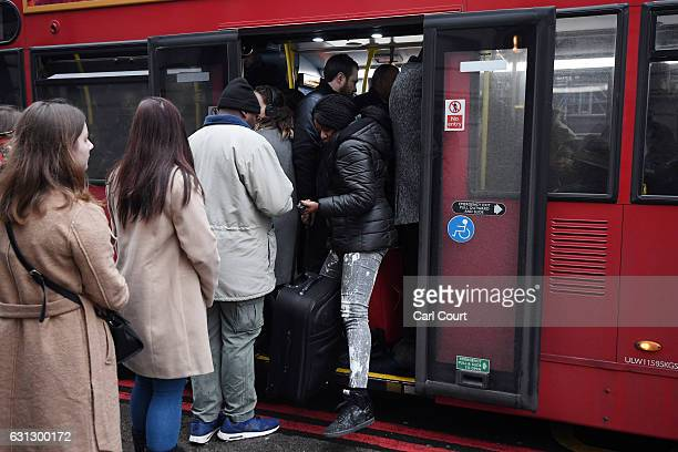 A woman squeezes past people as she disembarks a crowded bus at Victoria Station on January 9 2017 in London England Millions of people are facing...