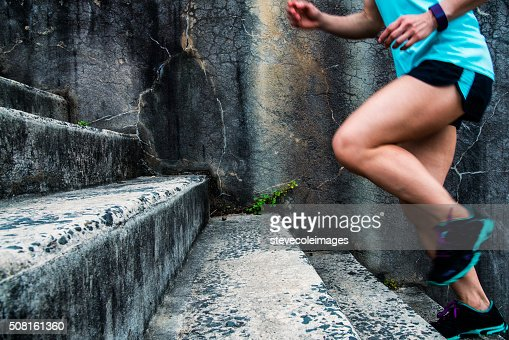 Woman stair climbing for exercise.