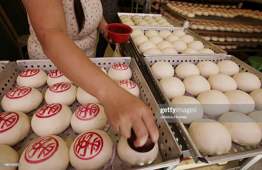 A woman stamps Cheung Chau Buns with red dye at the Cheung Chau Bun Festival on May 14, 2013 in Hong Kong, Hong Kong. Today is the start of the Cheung Chau Bun Festival which will run until 17 May and celebrates the eight day of the fourth moon in the Chinese calendar.