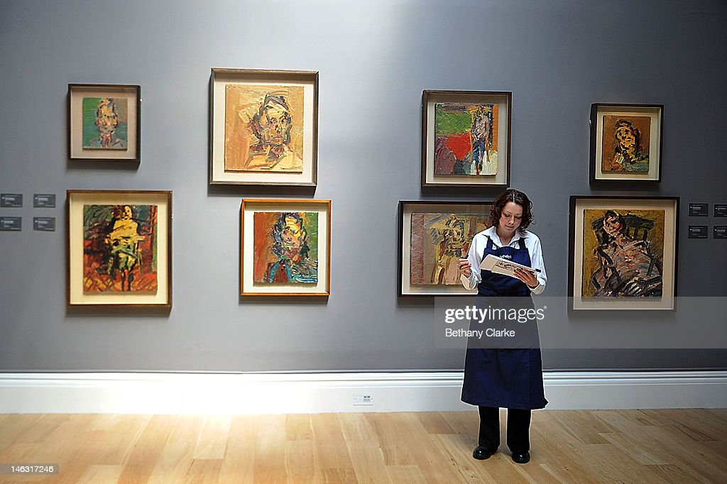 A woman stand infront of work by Frank Aue at Sotheby's on June 14, 2012 in London, England. These pieces are part of the Impressionist & Modern and Contemporary Art sale at Sotheby's which will be held on June 19, 2012 and June 20, 2012.