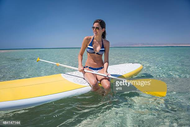 Woman Stand Up Paddling (SUP)