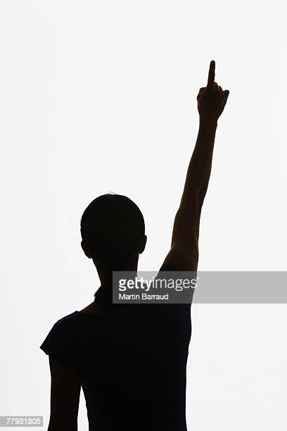 Woman standing and pointing straight up