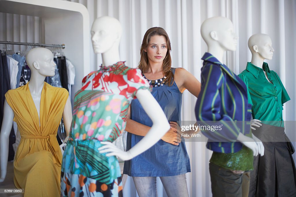 Woman standing and posing with mannequins : ストックフォト
