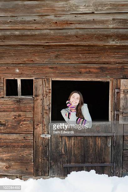 Woman standing at barn door