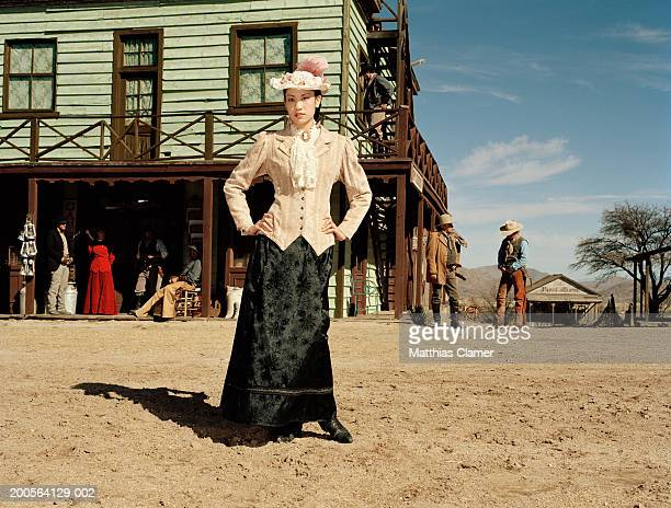 Woman standing at old west town, portrait