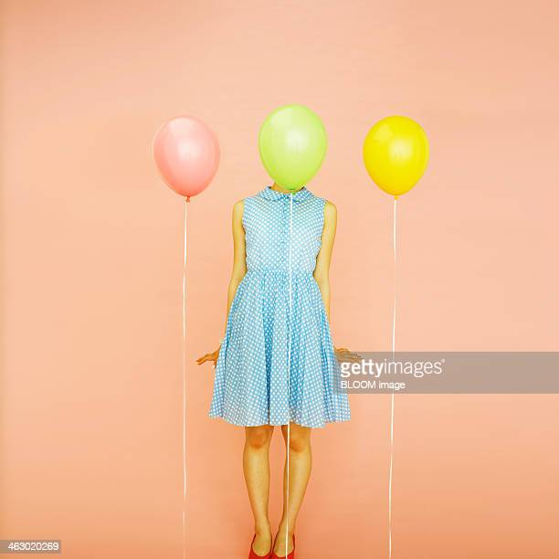 Woman Standing Behind Balloon